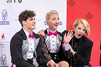 KELOWNA, BC - OCTOBER 25:  Canadian ice dancers Piper Gilles and Paul Poirier await their scores for rhythm dance at Skate Canada International with their coach Megan Wing at Prospera Place on October 25, 2019 in Kelowna, Canada. (Photo by Marissa Baecker/Shoot the Breeze)