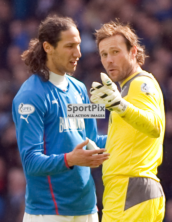 Rangers Bilel Moshni and Keeper Steve Simonsen talk after a defensive mix up