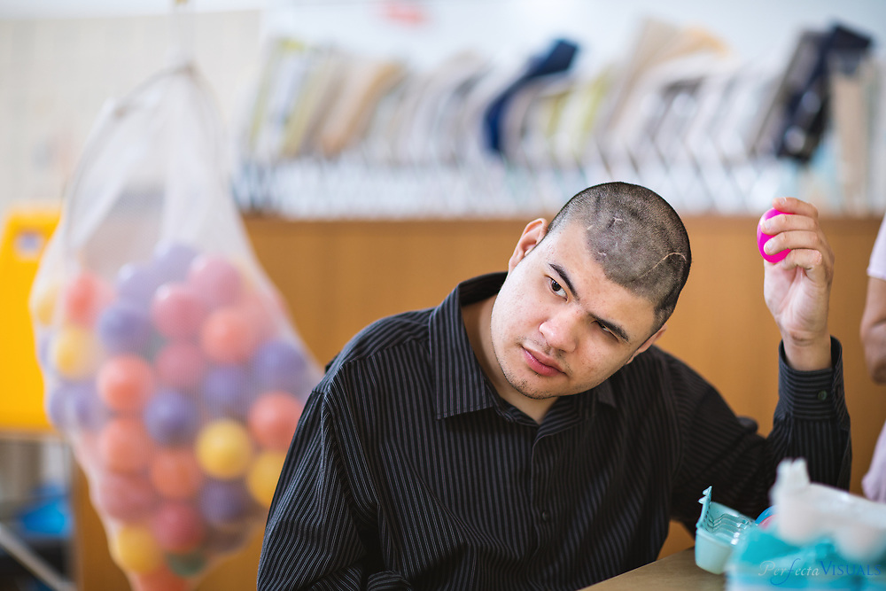 Anthony Nguyen is set to graduate after his time at CJ Greene Education Center. When he first arrived, Anthony was on a feeding tube and had many global challenges. Over the years, he approved physically, academically, and with all his skills. Despite some physical challenges, he is independent in many of his self-help skills and can make many of his wants and needs known verbally.<br /> <br /> Photographed, Monday, May 21, 2018, in Greensboro, N.C. JERRY WOLFORD and SCOTT MUTHERSBAUGH / Perfecta Visuals