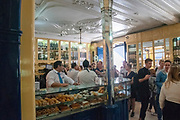 Customers queue up to buy the famous Belem pastry in the Pasteis de Belem bakery, Belem, Lisbon, Portugal