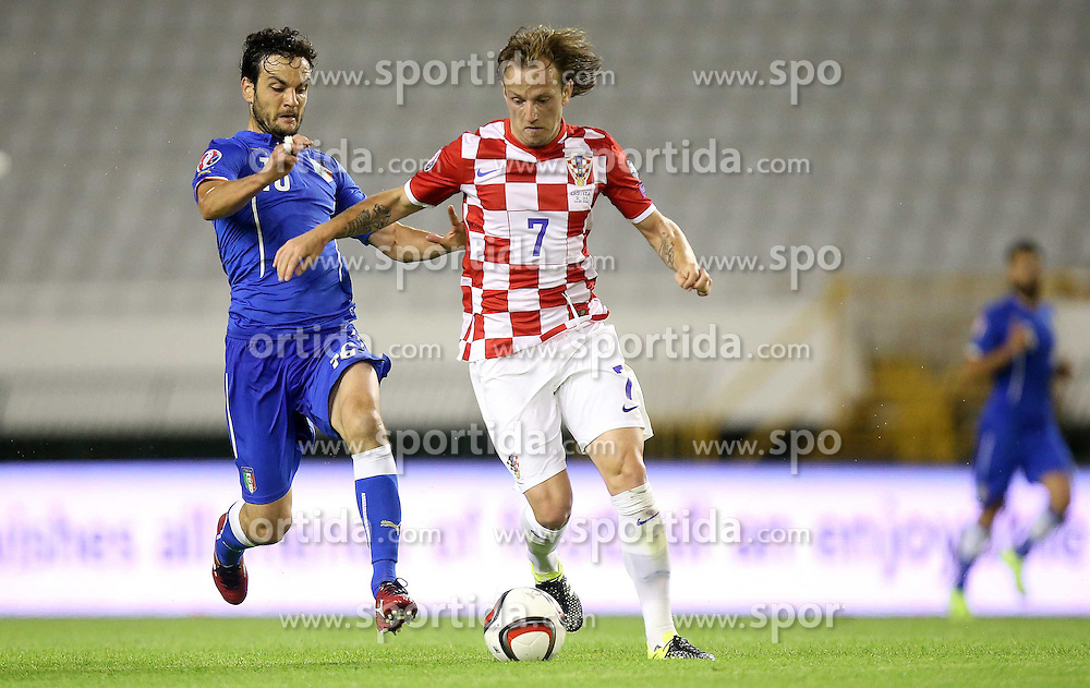 12.06.2015, Stadion Poljud, Split, CRO, UEFA Euro 2016 Qualifikation, Kroatien vs Italien, Gruppe H, im Bild Ivan Rakitic, Marco Parolo // during the UEFA EURO 2016 qualifier group H match between Croatia and and Italy at the Stadion Poljud in Split, Croatia on 2015/06/12. EXPA Pictures &copy; 2015, PhotoCredit: EXPA/ Pixsell/ Igor Kralj<br /> <br /> *****ATTENTION - for AUT, SLO, SUI, SWE, ITA, FRA only*****