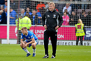 Gillingham FC manager Adrian Pennock and Gillingham FC midfielder Jake Hessenthaler (8) wait on the pitch for news from other grounds during the EFL Sky Bet League 1 match between Northampton Town and Gillingham at Sixfields Stadium, Northampton, England on 30 April 2017. Photo by Dennis Goodwin.