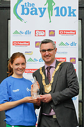 No fee for Repro:.Fiona Roach second place lady in a time of 36.07 minutes at the DLR Bay 10K road race pictured been presented with her prize by An Cathaoirleach Cllr Tom Joyce, Dun Laoghaire-Rathdown County Council. Pic Jason Clarke Photography