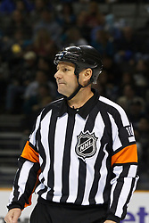 January 13, 2011; San Jose, CA, USA; NHL referee Paul Devorski (10) before a face off between the San Jose Sharks and the Edmonton Oilers during the first period at HP Pavilion.  Edmonton defeated San Jose 5-2. Mandatory Credit: Jason O. Watson / US PRESSWIRE