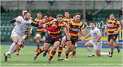 Carmarthen Quins' centre Josh Batcup makes a clean break despite the attentions of Merthyr's outside half Gareth Davies.<br /> <br /> Photographer: Dan Minto<br /> <br /> Indigo Welsh Premiership Rugby - Round 11- Merthyr RFC v Carmarthen Quins RFC - Saturday 21st December 2019 - Y Wern, Merthyr, South Wales, UK.<br /> <br /> World Copyright © Dan Minto Photography<br /> <br /> mail@danmintophotography.com <br /> www.danmintophotography.com