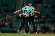 Stuart Meaker and Rikki Clarke of Surrey celebrate the wicket of Adam Hose during the NatWest T20 Blast South Group match between Surrey County Cricket Club and Warwickshire County Cricket Club at the Kia Oval, Kennington, United Kingdom on 25 August 2017. Photo by Dave Vokes.