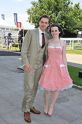 DAN STEVENS and SOPHIE McSHERA at the Investec Derby at Epsom Racecourse, Epsom Downs, Surrey on 4th June 2011.