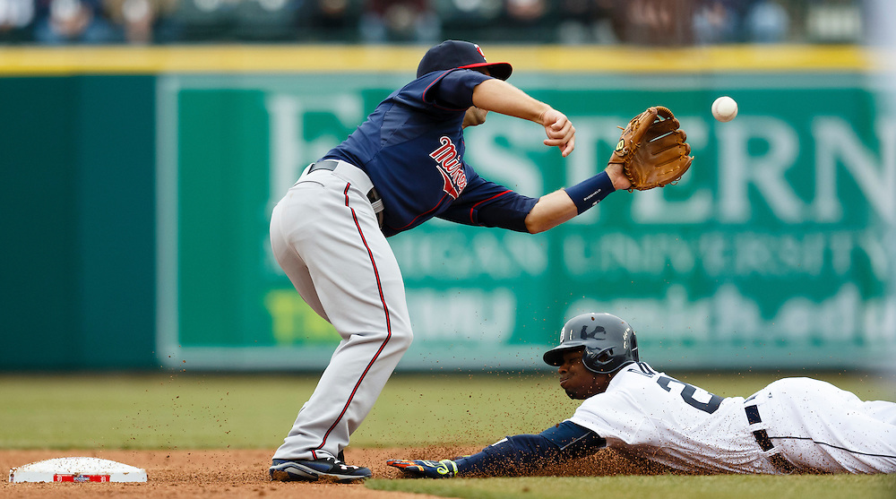 Apr 6, 2015; Detroit, MI, USA; Detroit Tigers left fielder Rajai Davis (20) steals second under the tag by Minnesota Twins second baseman Brian Dozier (2) at Comerica Park. Mandatory Credit: Rick Osentoski-USA TODAY Sports