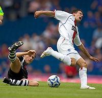 Fotball<br /> England 2005/2006<br /> Foto: SBI/Digitalsport<br /> NORWAY ONLY<br /> <br /> Rangers v Borussia Mönchengladbach, pre season friendly at Ibrox Park.<br /> <br /> Saturday 23/07/2005<br /> <br /> Novo is tackled by Oude-Kamphaus