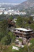 Visible when driving along the scenic Mulholland Drive, luxury mansions have been built on the hills surrounding Los Angeles, California, USA.