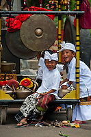 Boys and gamelan instruments at a village festival near Tabanan in Bali, Indonesia