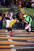 Pittsburgh Steelers wide receiver Antonio Brown (84) gets hit by Cincinnati Bengals free safety George Iloka (43) and Bengals cornerback Dre Kirkpatrick (27) as he catches a 6 yard touchdown pass that ties the fourth quarter score at 20-20 during the 2017 NFL week 13 regular season football game against the Cincinnati Bengals, Monday, Dec. 4, 2017 in Cincinnati. The Steelers won the game 23-20. (©Paul Anthony Spinelli)