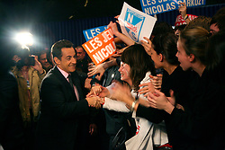 File photo - Interior Minister and presidential candidate Nicolas Sarkozy whakes hand with his fans during a public meeting at the Zenith in Nantes, France on March 15, 2007. Former French President Nicolas Sarkozy was in police custody on Tuesday morning March 20, 2018, an official in the country's judiciary said. He was to be questioned as part of an investigation into suspected irregularities over his election campaign financing, the same source added. The probe related to alleged Libyan funding for Sarkozy's 2007 campaign, Le Monde newspaper reported. Photo by Mehdi Taamallah/ABACAPRESS.COM