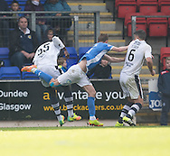 St Johnstone&rsquo;s Steven MacLean goes down after the challenge of Dundee&rsquo;s Kevin Gomis in the incident which led to the homes side being awarded a penalty - St Johnstone v Dundee, Ladbrokes Scottish Premiership at McDiarmid Park, Perth. Photo: David Young<br /> <br />  - &copy; David Young - www.davidyoungphoto.co.uk - email: davidyoungphoto@gmail.com