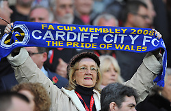 Cardiff City fan holds up a scarf. - Photo mandatory by-line: Alex James/JMP - Tel: Mobile: 07966 386802 03/11/2013 - SPORT - FOOTBALL - The Cardiff City Stadium - Cardiff - Cardiff City v Swansea City - Barclays Premier League
