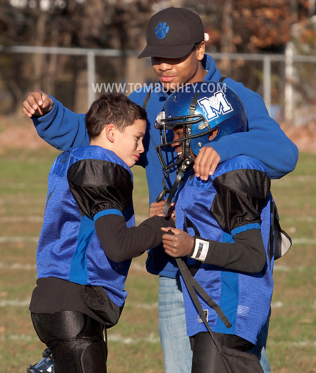 Middletown, New York - Tw Middletown players congratulate each ther after a victory over Port Jervis in an Orange County Youth Football League Division II semifinal playoff game at Watts Park on  Nov. 15, 2014.