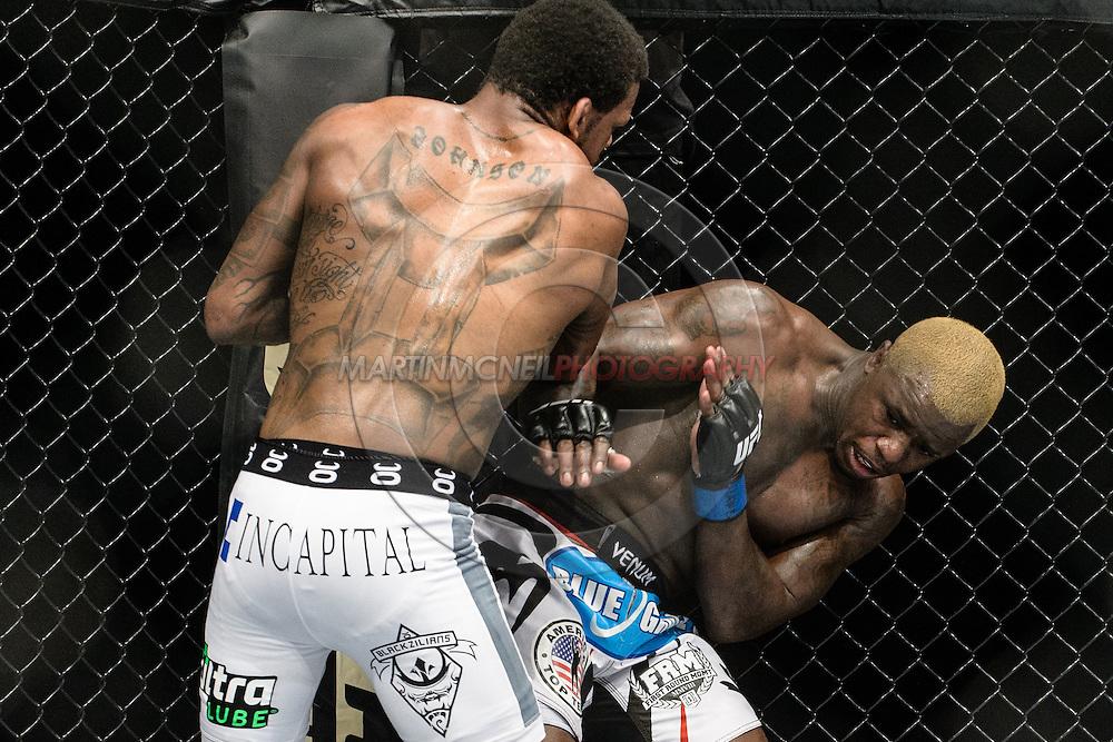 "LONDON, ENGLAND, MARCH 8, 2014: Michael Johnson Melvin Guillard during ""UFC Fight Night: Gustafsson vs. Manuwa"" inside the O2 Arena in Greenwich, London on Saturday, March 8, 2014 (© Martin McNeil)"