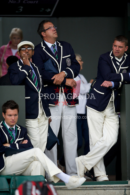 LONDON, ENGLAND - Tuesday, July 3, 2012: Line judges wait during the Girls' Singles 1st Round match on day eight of the Wimbledon Lawn Tennis Championships at the All England Lawn Tennis and Croquet Club. (Pic by David Rawcliffe/Propaganda)