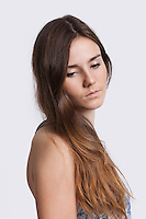 Thoughtful young woman over white background