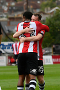 Goal - Reuben Reid (33) of Exeter City is congratulated with a hug by Jake Taylor (25) of Exeter City after scoring a goal to give a 1-0 lead to the home team during the EFL Sky Bet League 2 match between Exeter City and Lincoln City at St James' Park, Exeter, England on 19 August 2017. Photo by Graham Hunt.