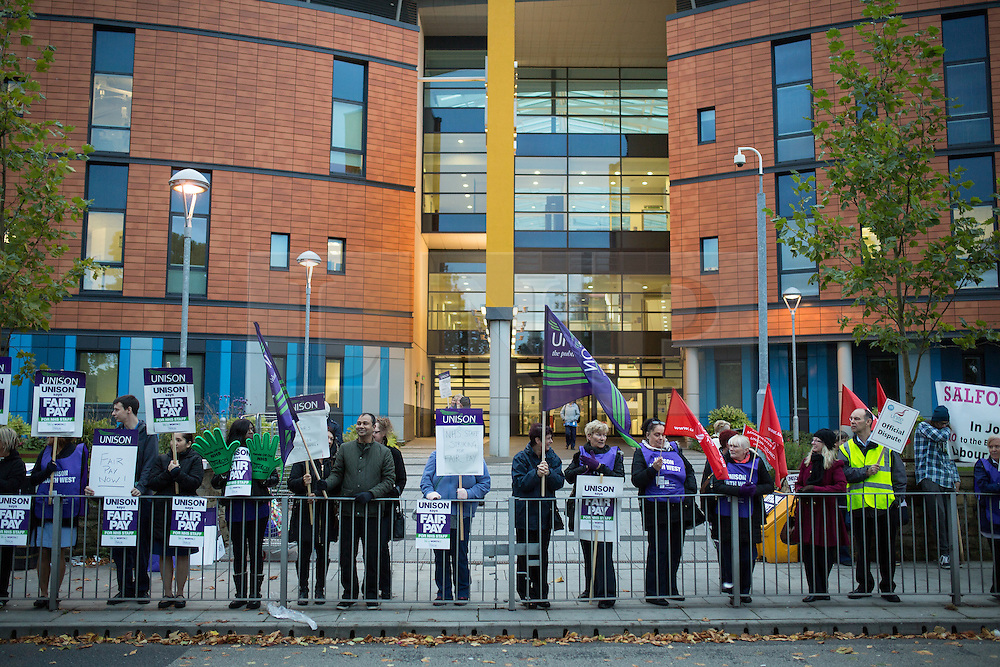 """© Licensed to London News Pictures . 13/10/2014 . Salford , UK . NHS staff picket outside the Salford Royal (formerly """" Hope """") Hospital in Greater Manchester as nurses, midwives and ambulance staff stage a four hour strike over pay .  Photo credit : Joel Goodman/LNP"""