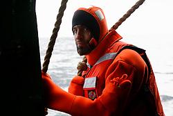 ATLANTIC OCEAN ABOARD ARCTIC SUNRISE 21MAY11 - Greenpeace activist David Major of Hungary in a survival suit aboard the Arctic Sunrise in the North Atlantic.....Photo by Jiri Rezac / Greenpeace