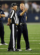 Dallas Cowboys head coach Jason Garrett complains to an official during the NFL week 6 football game against the Washington Redskins on Sunday, Oct. 13, 2013 in Arlington, Texas. The Cowboys won the game 31-16. ©Paul Anthony Spinelli