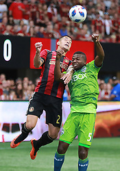 July 15, 2018 - Atlanta, GA, USA - Atlanta United defender Franco Escobar and Seattle Sounders defender Nouhou Tolo collide on a header during the first half on Sunday, July 15, 2018, in Atlanta, Ga. (Credit Image: © Curtis Compton/TNS via ZUMA Wire)