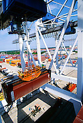 """Import containerized freight is offloaded from a container ship and onto waiting trailer trucks at a seaport dock. - To license this image, click on the shopping cart below - -- Determine pricing and license this image, simply by clicking """"Add To Cart"""" below --"""
