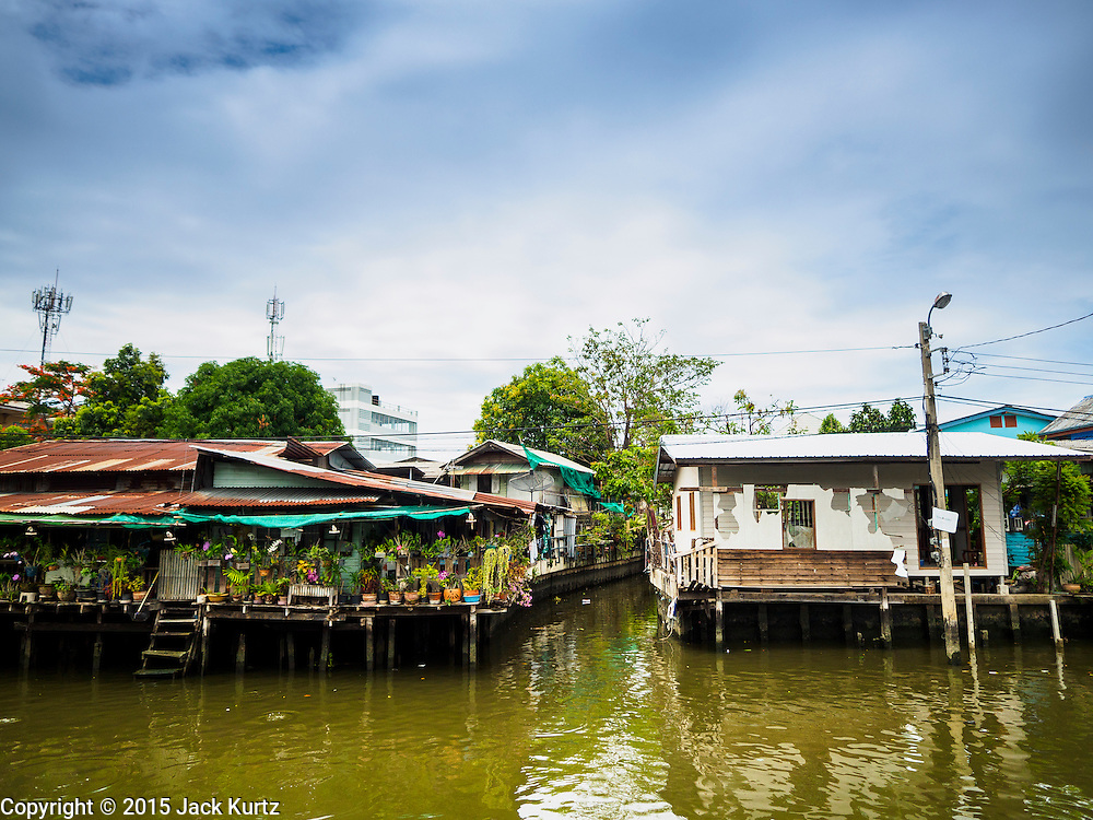 27 JUNE 2015 - BANGKOK, THAILAND:   The Bang Luang neighborhood lines Khlong (Canal) Bang Luang in the Thonburi section of Bangkok on the west side of Chao Phraya River. It was established in the late 18th Century by King Taksin the Great after the Burmese sacked the Siamese capital of Ayutthaya. The neighborhood, like most of Thonburi, is relatively undeveloped and still criss crossed by the canals which once made Bangkok famous. It's now a popular day trip from central Bangkok and offers a glimpse into what the city used to be like.       PHOTO BY JACK KURTZ