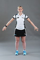 Umpire Alison Davies signalling obstruction of player without ball