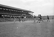 GAA All Ireland Senior Football Final Down v. Kerry 22nd September 1968 Croke Park..Two of the Down forwards coming in to attack the Kerry defence S. Burrows (extreme left) one of the Kerry full backs and D.O'Sullivan another Kerry Back (extreme right) are trying to tackle them *** Local Caption *** It is important to note that under the COPYRIGHT AND RELATED RIGHTS ACT 2000 the copyright of these photographs are the property of the photographer and they cannot be copied, scanned, reproduced or electronically stored in any form whatsoever without the written permission of the photographer