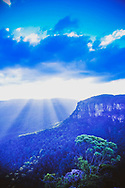 A blue-tinted vertical photo of the Blue Mountains in New South Wales, Australia