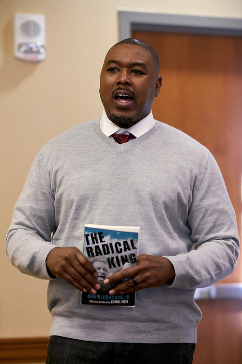 "Akil Houston pulls a quote from the book ""A Radical King""."
