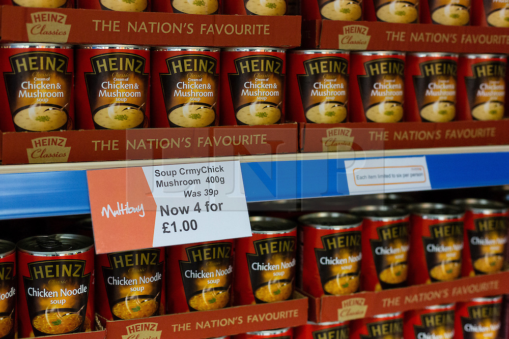 """© Licensed to London News Pictures. 19/12/2014. London, UK. Tins of Heinz soup on display in the Community Shop costing £1 for four tins. The Community Shop opened this week in Gipsy Hill, South London and is a """"social supermarket"""", which sells heavily-discounted surplus food that would otherwise be thrown away. Food is received from retail brands such as Marks & Spencer, Asda, Tesco, Innocent and Muller and many more. The shop works on a membership basis only, serving residents who are on income support and aimed at people who are in work, but low waged and for those working hard to find a job. Photo credit : Vickie Flores/LNP"""
