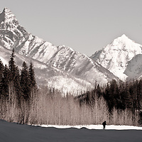 man photographing glacier national park winter scene