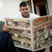02/07/2012. Senegal, Dakar. One day with the White Lion.  The canarian wrestler Juan Espino is the unique white fighter in the senegalese wrestling. Juan is reading a sports newspaper a day before his fight against Keur Dième .  ©Sylvain Cherkaoui