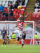 12th August 2017, SuperSeal Stadium, Hamilton, Scotland; SL Football league Hamilton Academicals versus Dundee; Dundee's Kerr Waddell beats Hamilton's David Templeton in the air