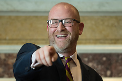 © Licensed to London News Pictures . 27/03/2017 . London , UK . UKIP leader PAUL NUTTALL delivers a speech setting out six tests on which UKIP will judge British Prime Minister Theresa May's Brexit negotiations , at the Marriott County Hall in Westminster . On Wednesday the British Government will trigger Article 50 of the Lisbon Treaty and commence Britain's withdrawal from the European Union . Photo credit : Joel Goodman/LNP