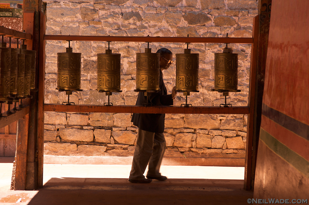 A Tibetan man spins prayer wheels in a monastery near the Barkor in Lhasa, Tibet.