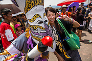 28 JUNE 2014 - DAN SAI, LOEI, THAILAND: People in ghost costumes walk though Dan Sai during the Ghost Festival parade. Phi Ta Khon (also spelled Pee Ta Khon) is the Ghost Festival. Over three days, the town's residents invite protection from Phra U-pakut, the spirit that lives in the Mun River, which runs through Dan Sai. People in the town and surrounding villages wear costumes made of patchwork and ornate masks and are thought be ghosts who were awoken from the dead when Vessantra Jataka (one of the Buddhas) came out of the forest.   PHOTO BY JACK KURTZ