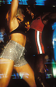 A woman in hot pants dancing, Ibiza, 1999.