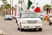 10 APRIL 2006 - PHOENIX, AZ: A pickup truck flying Mexican and American flags drives through downtown Phoenix, AZ. More than 200,000 people participated in a march for immigrants's rights in Phoenix Monday. The march was a part of a national day of action on behalf of undocumented immigrants. There were more than 100 such demonstrations across the US Monday. Protestors were encouraged to wear white, to symbolize peace, and wave American flags, to demonstrate their patriotism to the US.  Photo by Jack Kurtz