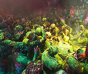 Festival of Holi - Braj people drenched in colors perfoming the ritual known as Samaaj at Barsana