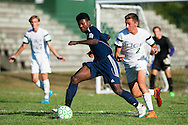Burlington's Maenda Beinfait Badibang (21) runs past Rice's Brent McKeown (2) with the ball during the boys soccer game between the The Burlington Seahorses and the Rice Green Knights at Rice Memorial high School on Tuesday afternoon September 15, 2015 in South Burlington, Vermont. (BRIAN JENKINS/for the FREE PRESS)