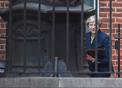 © Licensed to London News Pictures. 09/07/2018. London, UK. British Prime Minister THERESA MAY is seen leaving Downing Street the day after the resignation of former Brexit Secretary David Davis. Photo credit: Ben Cawthra/LNP