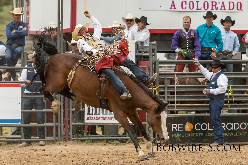Bareback rider XXX rides Summit Pro Rodeo's XXX during the third performance of the Elizabeth Stampede on Sunday, June 3, 2018.