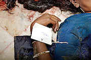 The body of a young women lies on The day after the Tsunami hit - The floor in a packed morgue in Madras. Over seven thousand people have been killed in India when a Tsunami crashed into the shoreline of southern India.