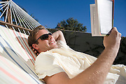 Man Reading in Hammock