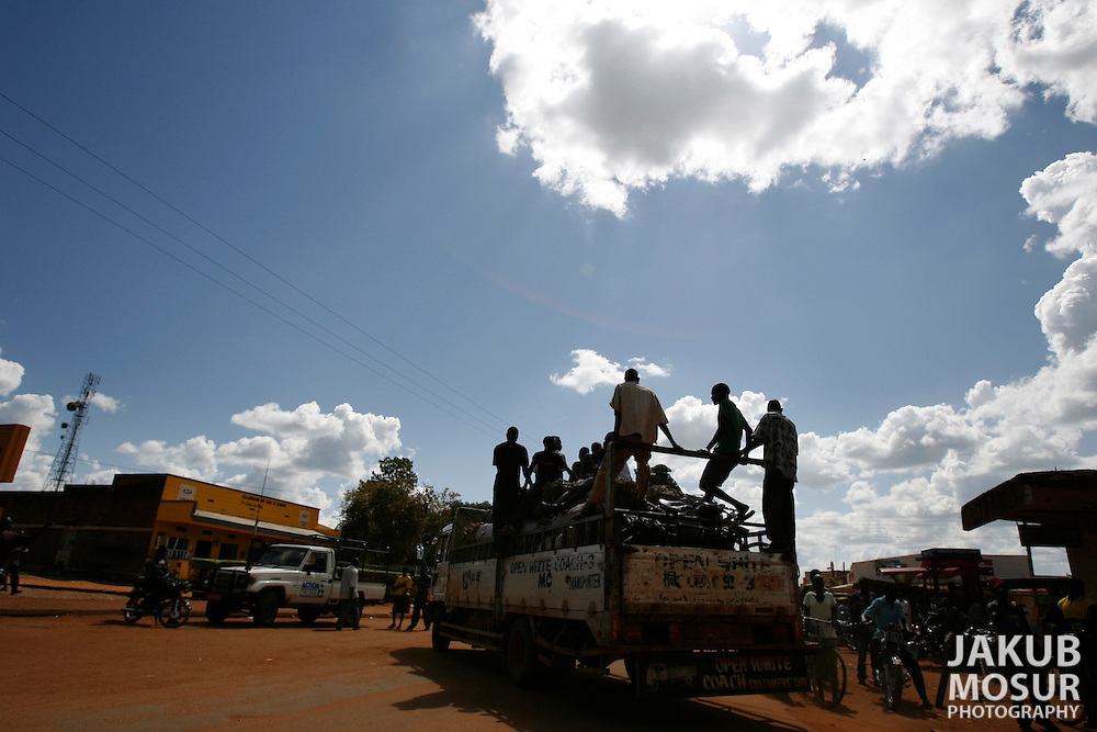 October 5, 2006 - Men ride on the back of a truck in Gulu in north Uganda. Gulu is the main base for the Uganda Peoples Defense Force fighting the insurgent Joseph Kony's Lord's Resistance Army. Kony's LRA movement has been fighting for the past 20 years to force the East African country to be ruled according to the Christian Ten Commandments. Over 2 million people, mostly of the Acholi tribe, have moved or were forced to move from their villages to camps close to the towns of Gulu, Lira, and Kitgum where they are watched over by the Ugandan Army. The LRA rebels have abducted thousands of children and have forced them to fight against the Ugandan Army and the Acholi people. Current peace talks between Kony's LRA and the Ugandan government held in Juba, southern Sudan, offer a glimpse of hope to ending this ongoing conflict..(Photo by Jakub Mosur/Polaris)<br />